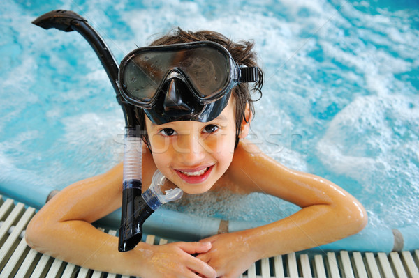 Kid in pool with diving equipment Stock photo © zurijeta