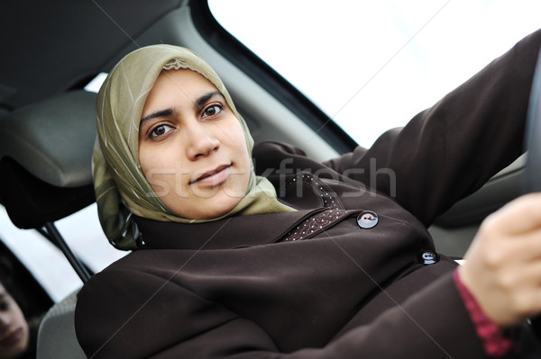 Arabic Muslim woman driving car wearing traditional scarf Stock photo © zurijeta