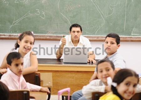 Interaction between teacher and children, funny class in school Stock photo © zurijeta