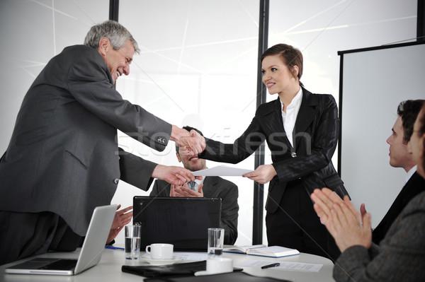 Happy business leaders handshaking at meeting Stock photo © zurijeta