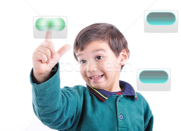 Little cute child pressing digital buttons on touchscreen, ideal for your concept Stock photo © zurijeta