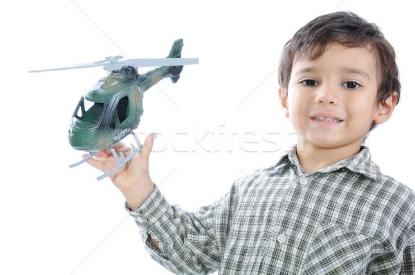 Gyerek helikopter arc jókedv fiú bolt Stock fotó © zurijeta