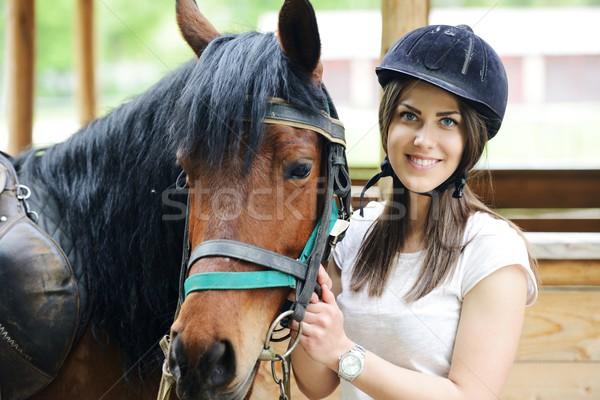 Hermosa niña equitación toma atención caballo granja Foto stock © zurijeta