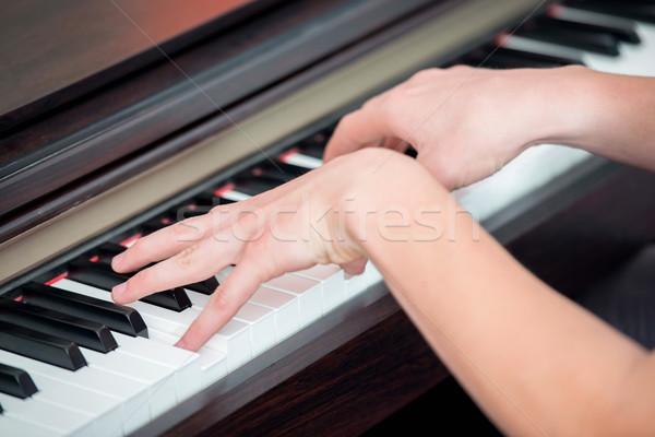 Musician playing piano Stock photo © zurijeta