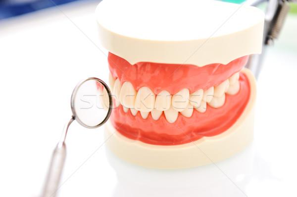 Dental mirror and teeth Stock photo © zurijeta