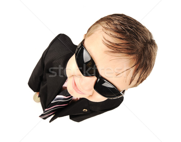 Adorable little kid wearing a suite and sunglasses Stock photo © zurijeta