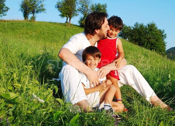 Genç baba beyaz çocuklar güzel çayır Stok fotoğraf © zurijeta