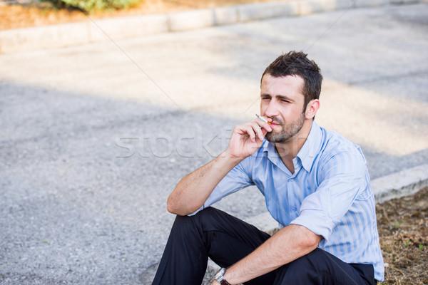 Dohányzás járda modern néz férfi cigaretta Stock fotó © zurijeta