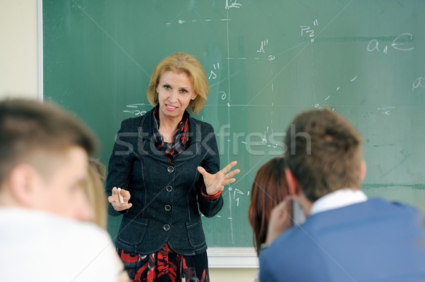 Professor palestra professor estudantes sala de aula mulher Foto stock © zurijeta