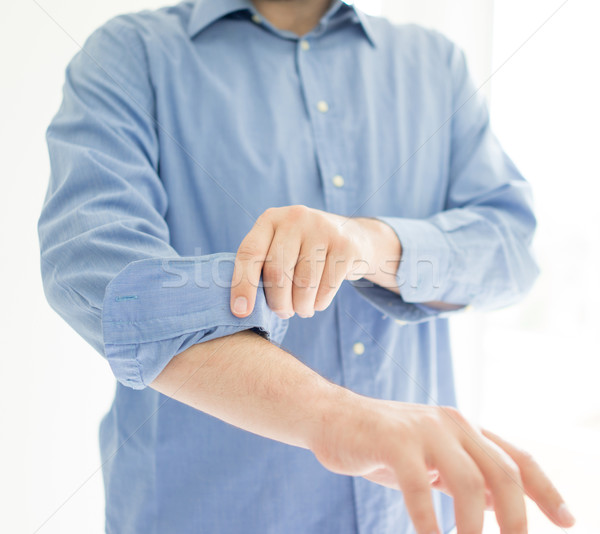Businessman rolling his sleeves ready to work Stock photo © zurijeta