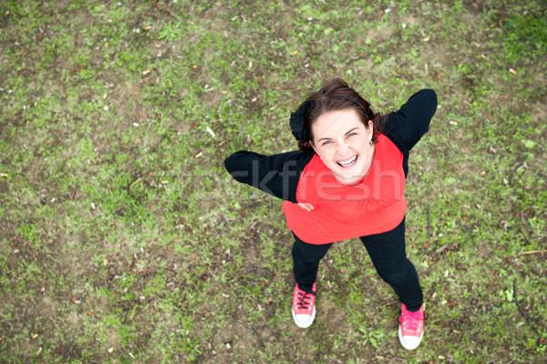 Smiling girl shot from above Stock photo © zurijeta
