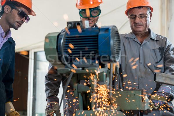 Industrial background. Welder in a factory Stock photo © zurijeta