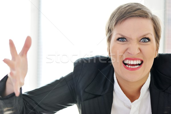 Angry mad furious businesswoman Stock photo © zurijeta