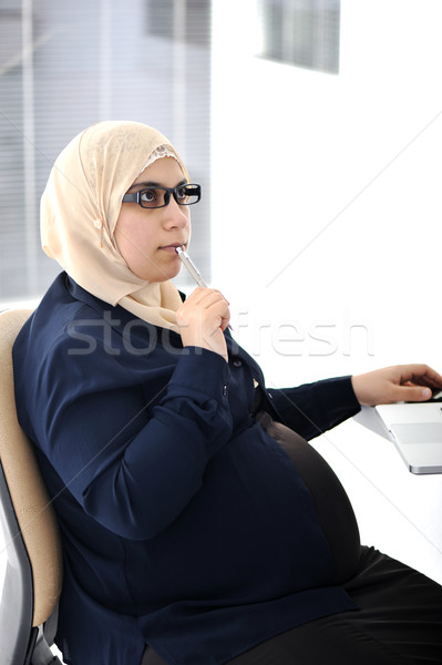 Pregnant Muslim Arabic business woman working at office Stock photo © zurijeta