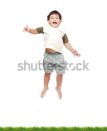 Mutlu küçük çocuk beyaz elbise atlama Stok fotoğraf © zurijeta