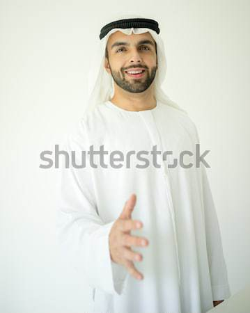 Young Arabic business man hand shaking for new contract Stock photo © zurijeta