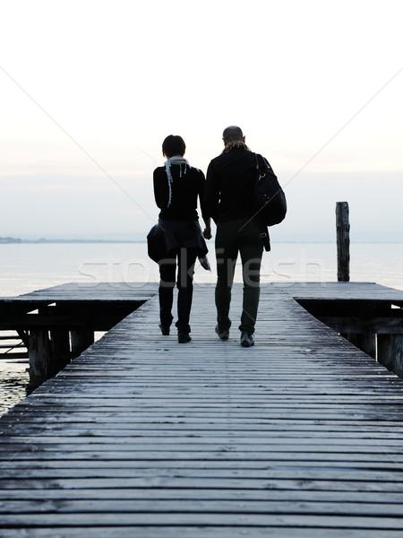 Couple by the wooden dock on a beautiful lake Stock photo © zurijeta