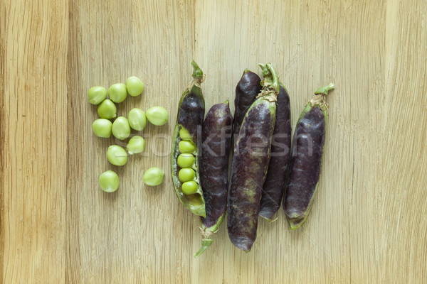 fresh violet peas isolated on a wooden background Stock photo © Zuzuan