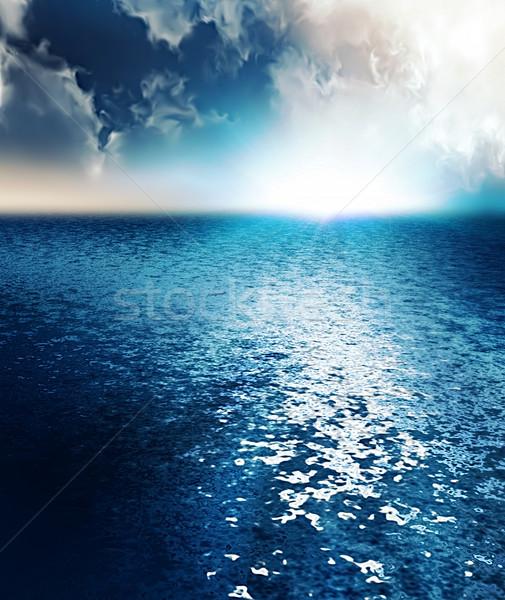 Nascer do sol oceano computador gerado água nuvens Foto stock © zven0