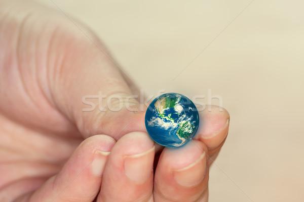 Küçük dünya el arka plan toprak mavi Stok fotoğraf © zven0