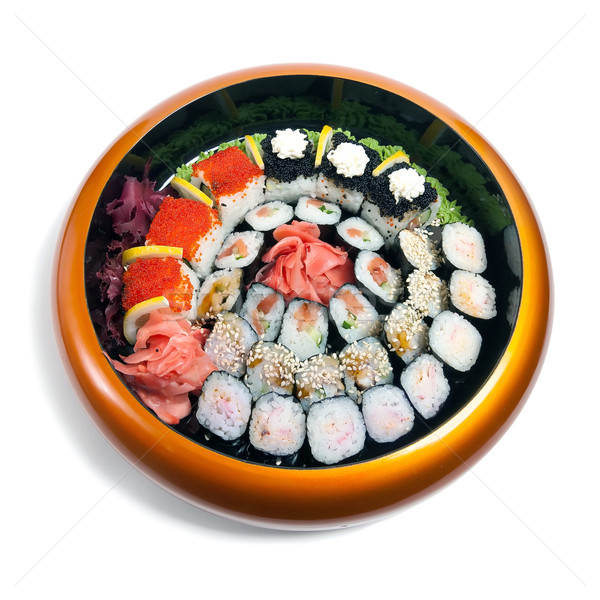Set of sushi in wooden circle plate Stock photo © zybr78