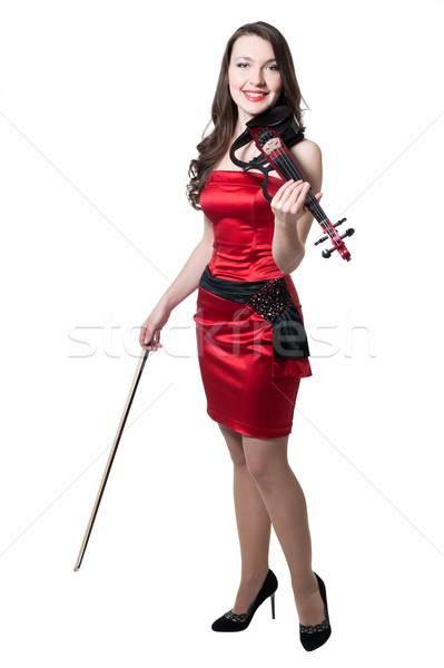Hegedűművész lány vörös ruha izolált fehér nő Stock fotó © zybr78