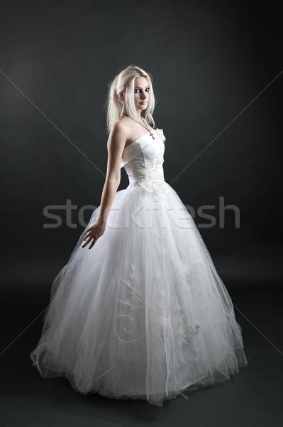 Girl in white dress on black background Stock photo © zybr78