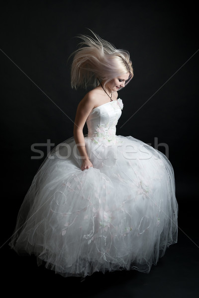 Beautiful girl in white dress on black background Stock photo © zybr78